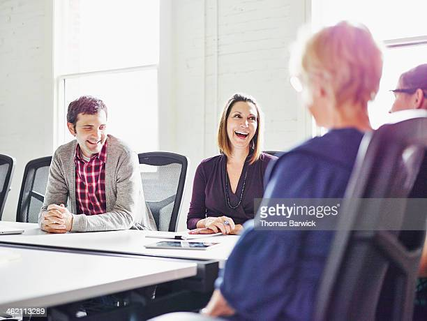 Laughing group of coworkers in conference room