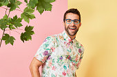 Laughing guy in spectacles and shirt, portrait