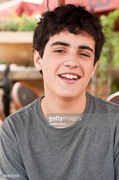 Laughing hispanic teenage boy