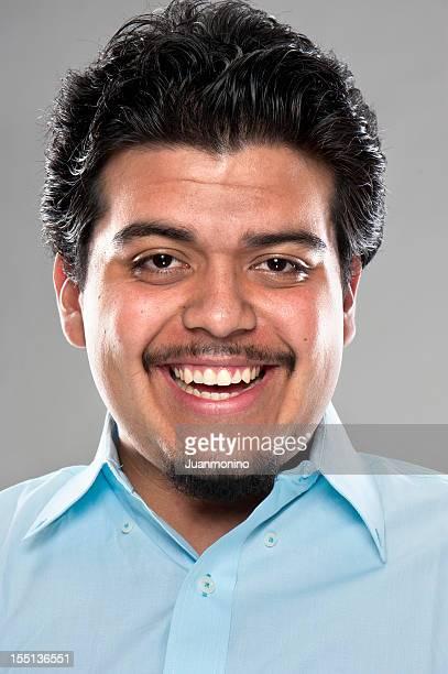 Laughing hispanic young man (real people)