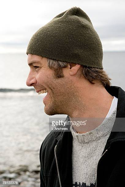 A laughing man by the sea.