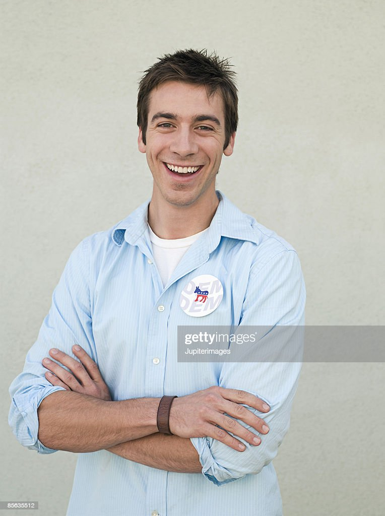 Laughing man wearing vote button : Stock Photo