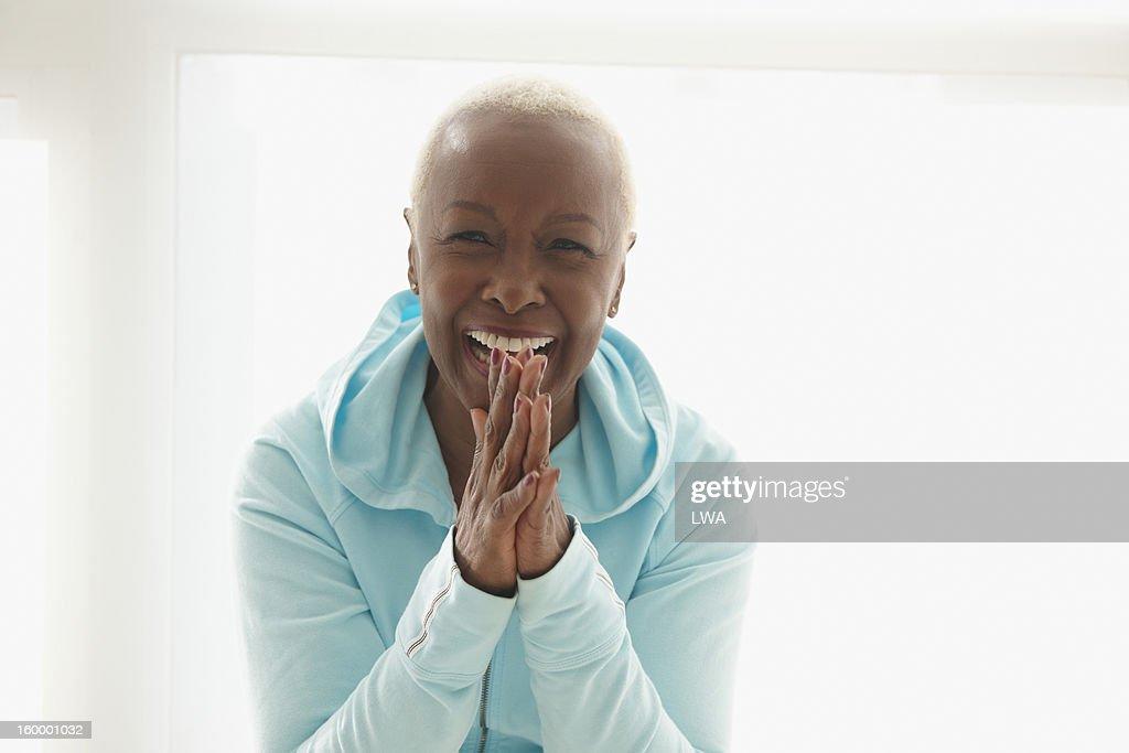 Laughing mature woman : Stock Photo