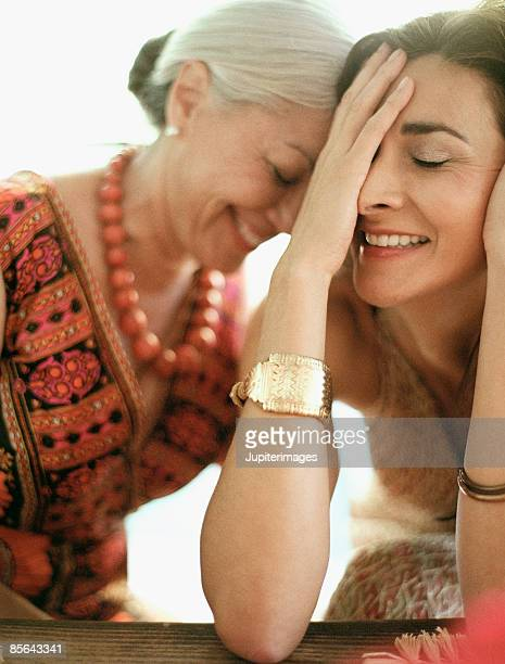 Laughing mother and daughter