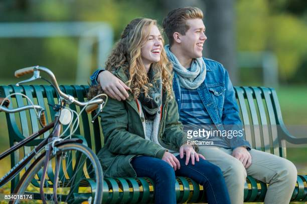 Laughing On A Bench