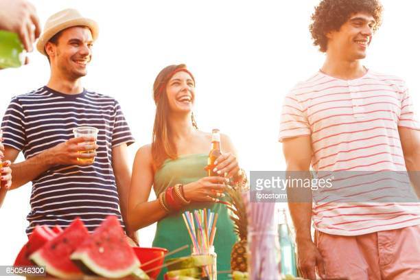 Laughing people having drinks on a party
