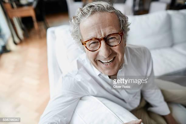 Laughing senior man at home