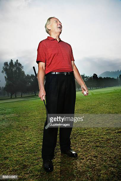 Laughing senior man on golf course
