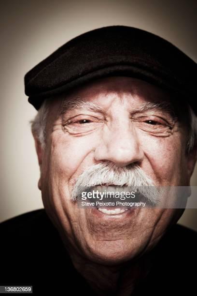 Laughing senior man wearing cap