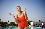 Laughing senior woman swimmer