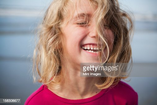 A laughing six year old girl. A portrait. : Stock Photo