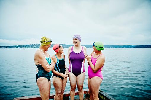 Laughing swimmers preparing for morning swim
