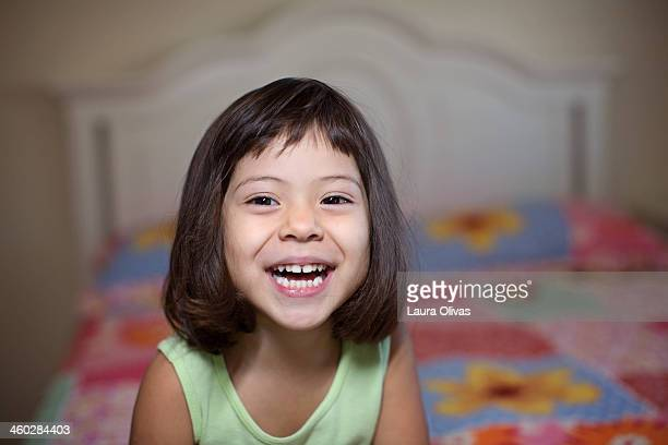 Laughing Toddler By Her Bed