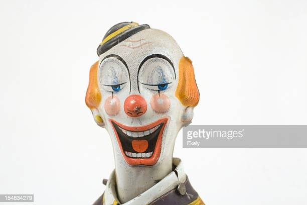 Laughing vintage tin toy clown with finely painted features.