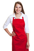 Laughing waitress with red apron and  blond hair on an isolated white background for cut out