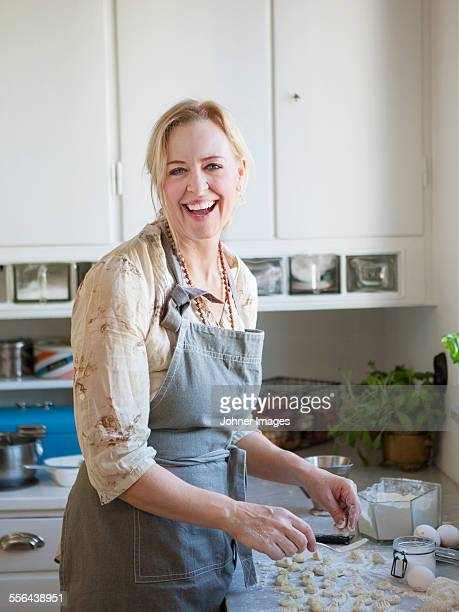 Laughing woman cooking