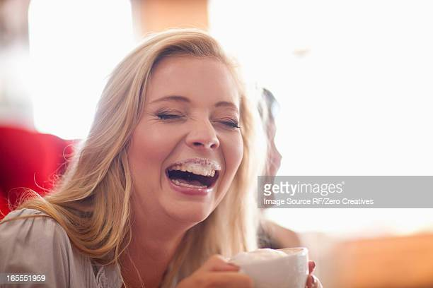 Laughing woman with milk mustache