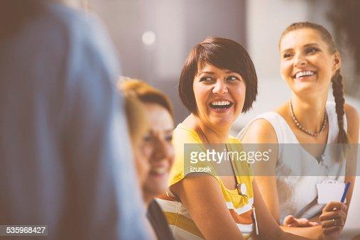 Laughing women on seminar : Stock Photo