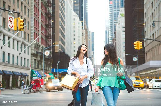 Laughing women with shopping bags in New York City