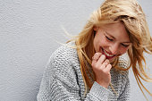 Laughing young blond lady in grey