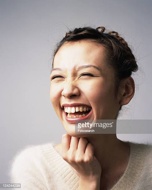 Laughing Young Woman, Side View
