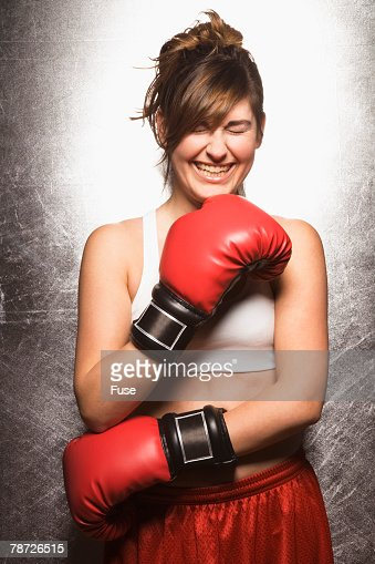 Laughing Young Woman with Boxing Gloves