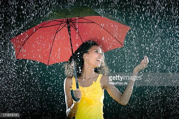 Laughing Young woman with umbrella enjoying rain