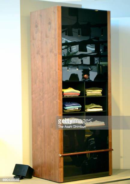 'Laundroid' a worldfirst 'intelligent' closet that sorts and folds clothes developed by Seven Dreamers Laboratories Inc is unveiled on May 30 2017 in...