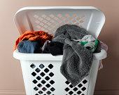 Laundry basket filled with washing, close-up