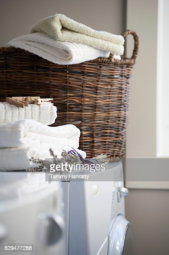 Laundry basket on machine : Stock Photo