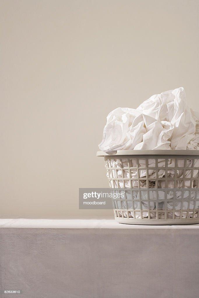 Laundry basket on table : Stock Photo