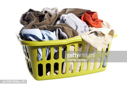 Laundry basket with clothes on white background