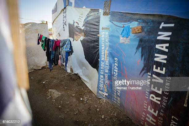 Laundry dries in a refugee camp in the Bekaa plain next to a tent built of old movie posters on October 06 2016 in Bar Elias Lebanon