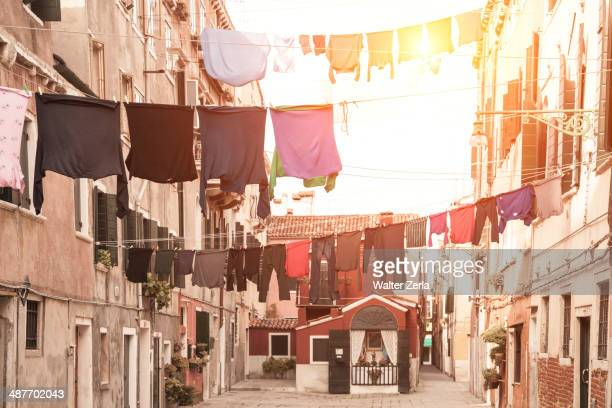 Laundry hanging from apartment buildings