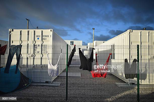 Laundry hangs near a new migrant camp under construction near the camp known as 'The Jungle' on January 15 2016 in Calais France Thousands of...