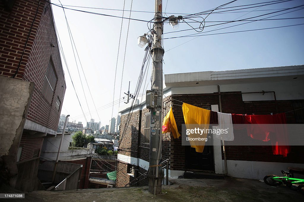 Laundry is hung out to dry next to residential buildings in the area of Hannam-dong in Seoul, South Korea, on Wednesday, July 24, 2013. South Koreas economy grew the most in more than two years, on stronger government spending and private consumption even as a slowdown in China clouds the outlook. Photographer: Woohae Cho/Bloomberg via Getty Images