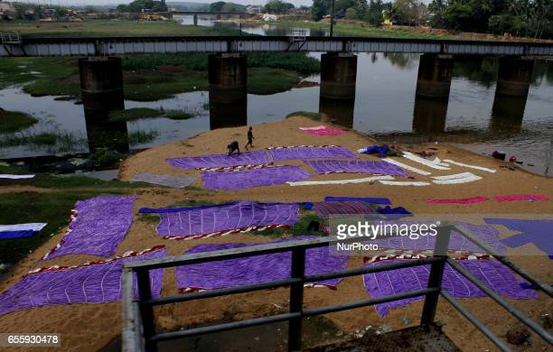 Laundry men looks on the send bed of a river as they are busy in the tent house cloth dying works outskirts of the eastern Indian city Bhubaneswar on...