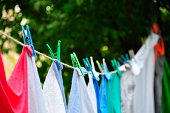 (colorful clothes) laundry hanging on a clothesline outdoor