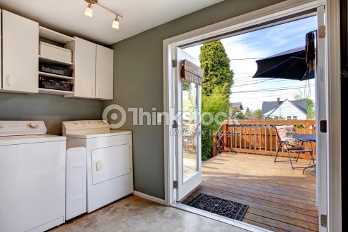 Laundry room with exit to walkout deck stock photo - Lavado y planchado ...