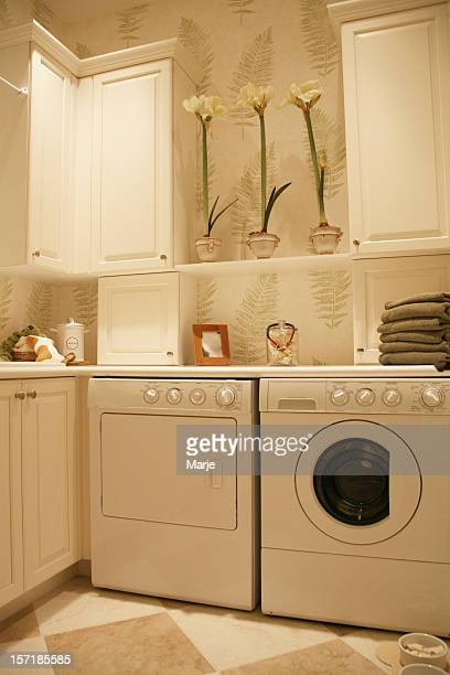 Laundry room with washer and dryer and cabinets