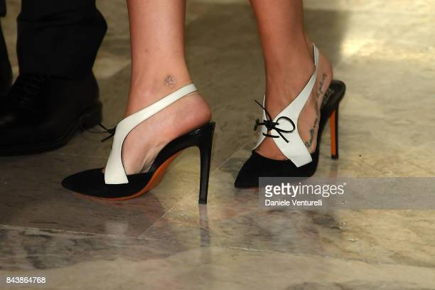 Laura Adriani shoes detail walks the red carpet ahead of the 'Emma ' screening during the 74th Venice Film Festival at Sala Grande on September 7...
