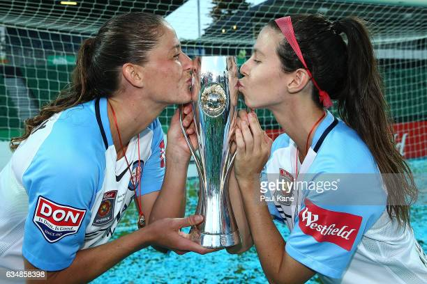 Laura Alleway and Erika Tymrak of Melbourne City kiss the trophy after winning the 2017 WLeague Grand Final match between the Perth Glory and...