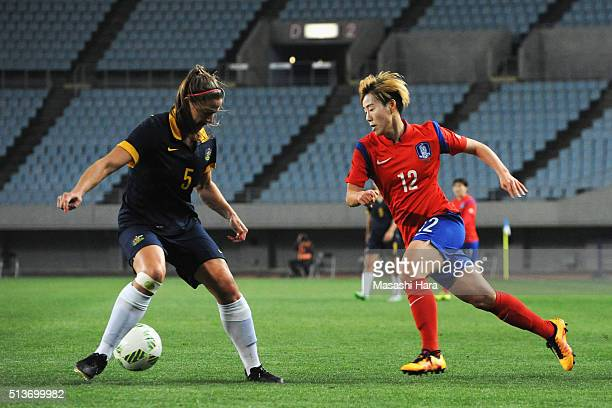 Laura Alleway of Australia and Yoo Young A of South Korea compete for the ball during the AFC Women's Olympic Final Qualification Round match between...