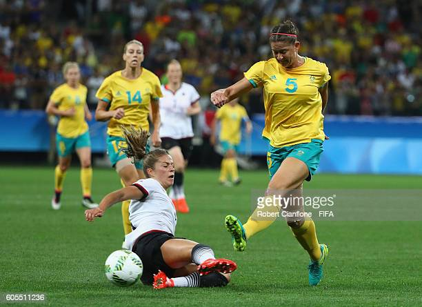 Laura Alleway of Australia is challenged by Melanie Leupolz of Germany during the Women's First Round Group F match between Germany and Australia on...