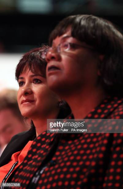 Laura Alvarez wife of Labour leader Jeremy Corbyn sits next to shadow home secretary Diane Abbott as they listen to speeches at the Labour Party...