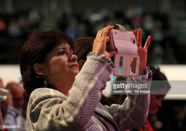 Laura Alvarez wife of Labour leader Jeremy Corbyn takes a picture during the Labour Party annual conference at the Brighton Centre Brighton