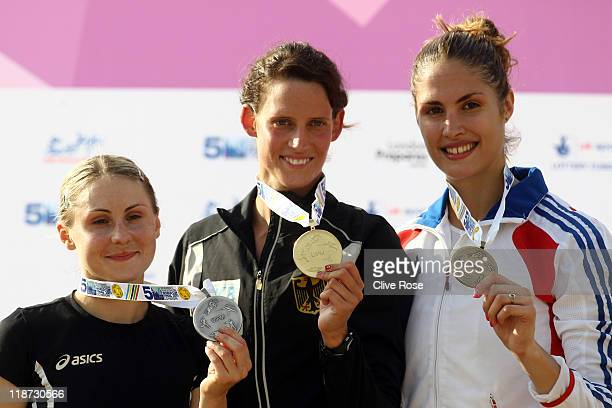 Laura Asadauskaite of Lithuania Lena Schoneborn of Germany and Elodie Clouvel of France celebrate on the podium after the UIPM World Cup Final as...