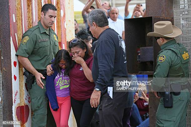 TOPSHOT Laura Avila hugs her daughter Laura Vera Martinez after seeing relatives in Mexico when they were allowed to meet after a door was opened...