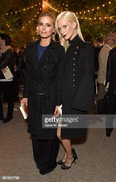 Laura Bailey and Poppy Delevingne wearing Burberry at the Burberry September 2016 show during London Fashion Week SS17 at Makers House on September...