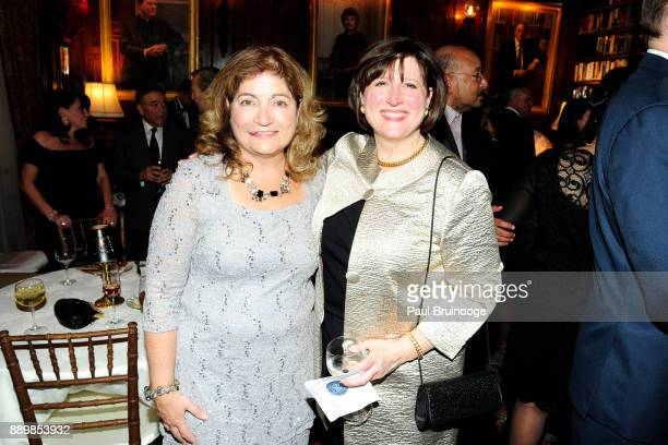 Laura Barrett and Amy Massimo attend the Hackensack University Medical Center Foundation Holiday Party Hosted by Jon Fitzgerald Diane Reynolds at The...
